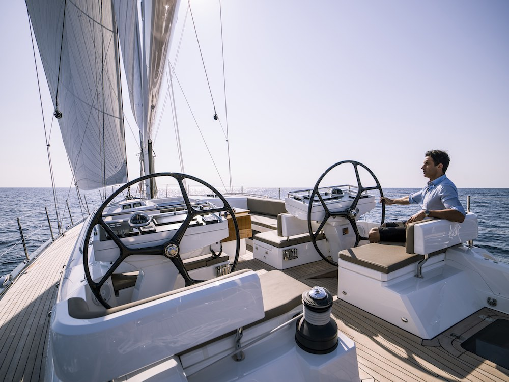 All sail handling, other than halyards, takes place aft of the helm stations.